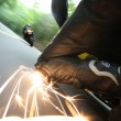 Sparks Fly as Rider Touches the Road